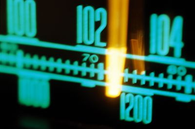 A close-up photo of a radio station dial on a home stereo system.