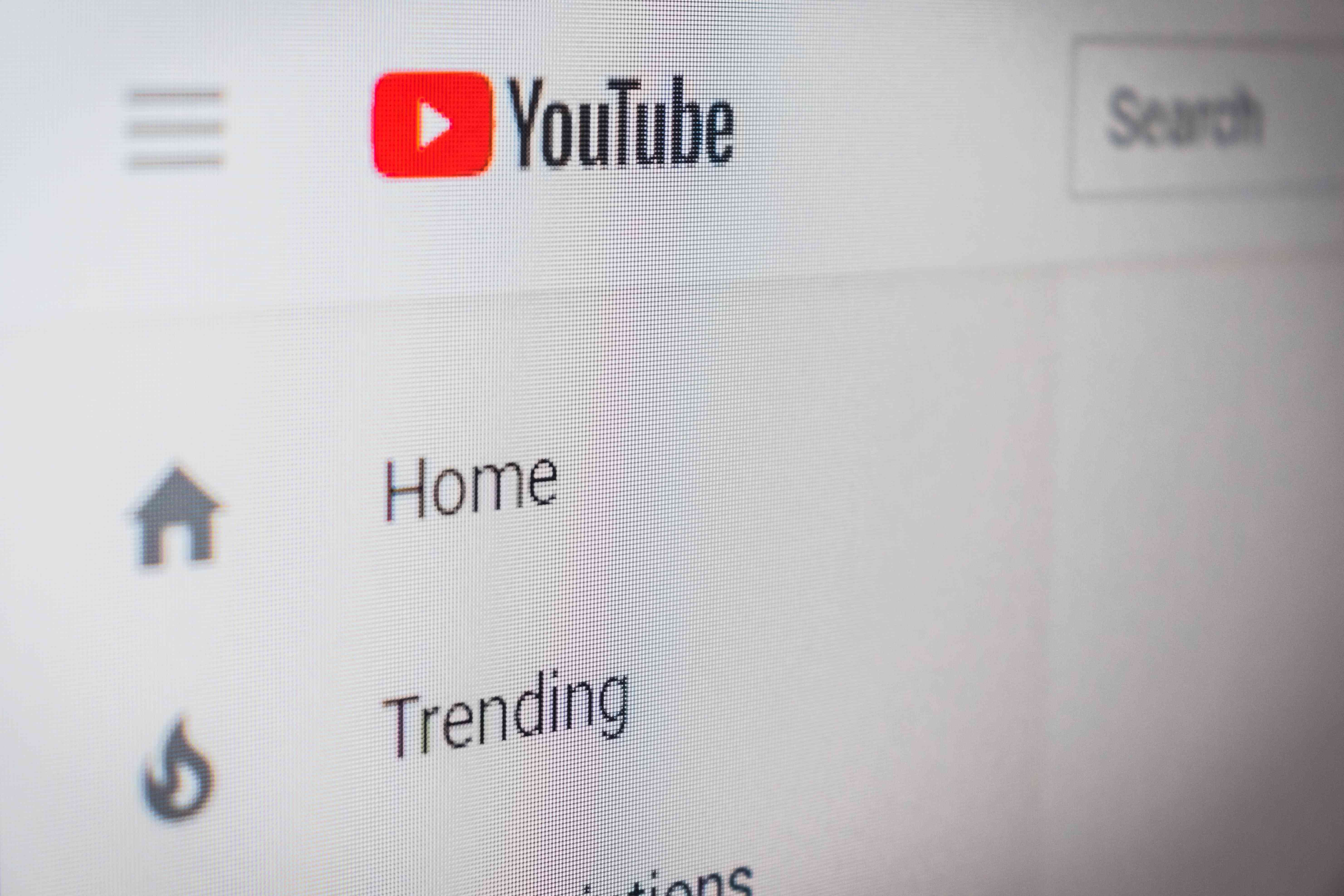 A closeup of the YouTube app in a web browser, showing the Home, Trending, and Search features.