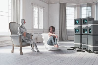 A robot and a person sharing a living space.