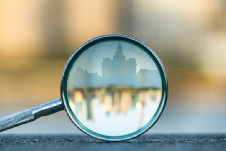 City scape through the lens of a magnifying glass