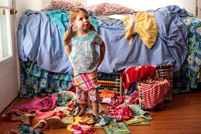 Little girl in messy room