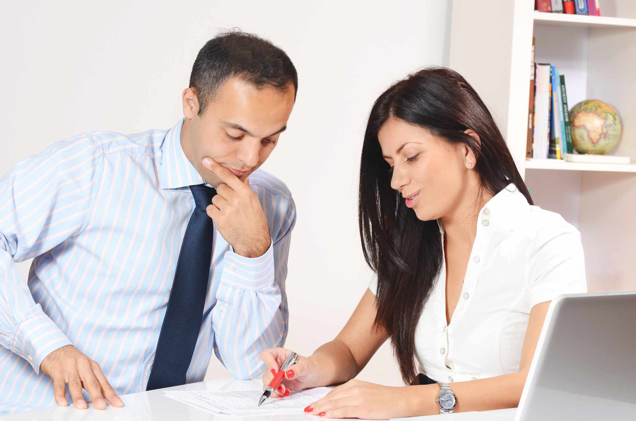 Man and woman looking over paperwork at a table