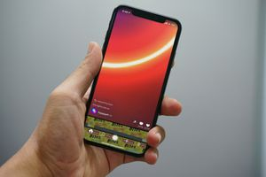 Hand holding iPhone X with byte app on screen