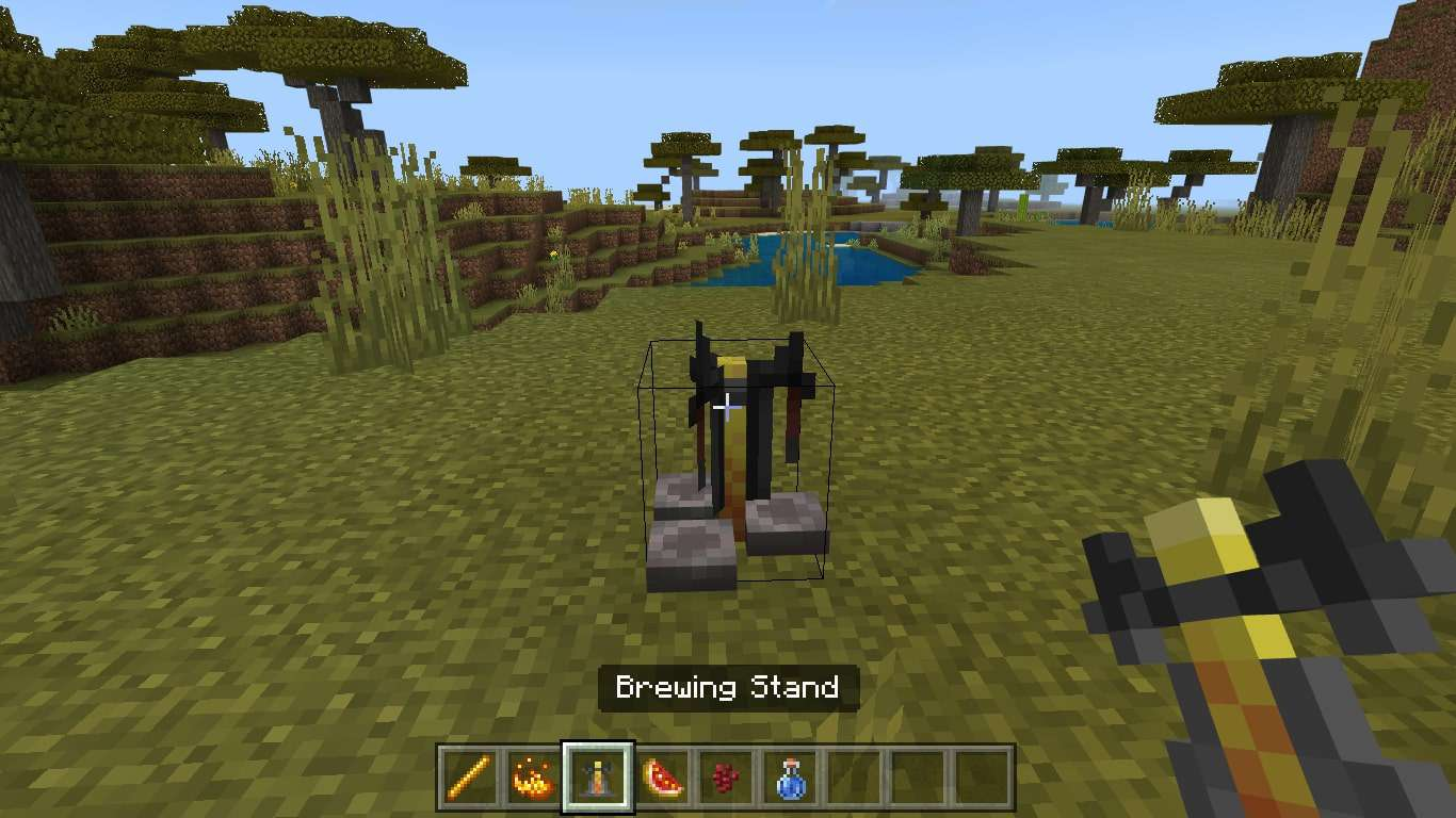 Place the brewing stand on the ground and interact with it to access the brewing menu.