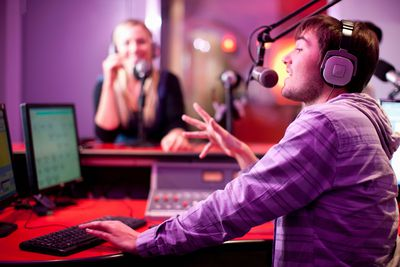 Podcast hosts broadcasting in a recording studio
