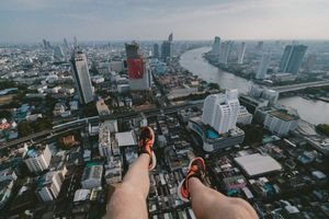 Photo of a man hanging above Bangkok, Thailand