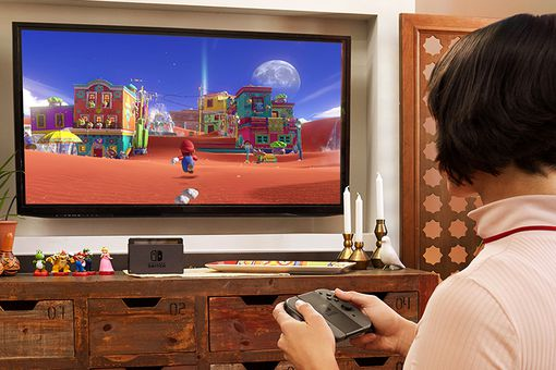 Woman playing a Nintendo Switch on her TV