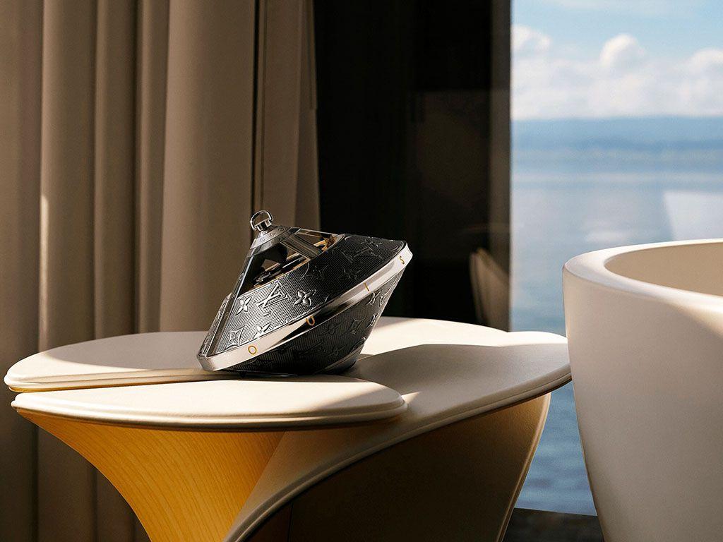 Louis Vuitton's $2,890.00 Horizon Light Up Speaker on a fancy side table