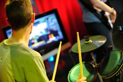 Drummer playing in a Rock Band party