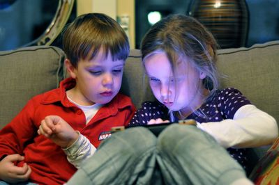 Kids using an iPad