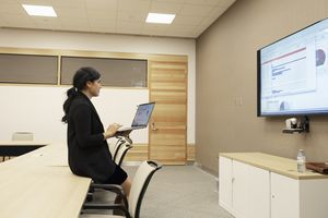 Businesswoman preparing audio visual presentation in conference room
