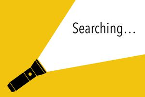Illustration of a flashlight spotlighting the word searching...