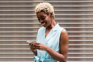 Social media influencer looking at phone