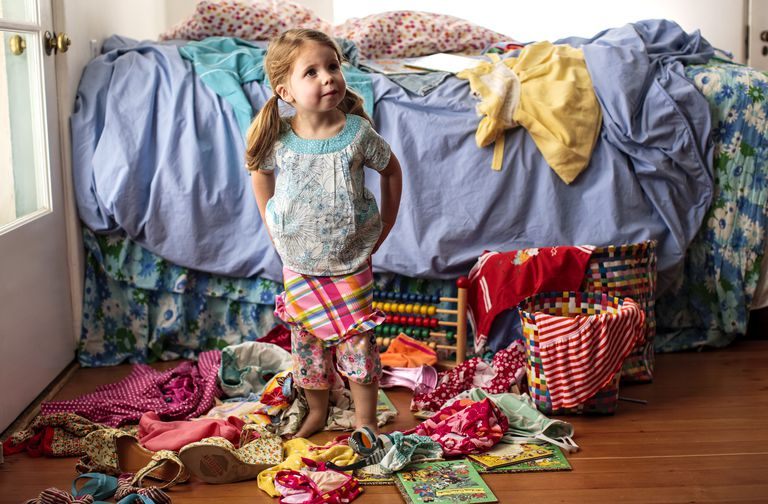 Little girl in messy room