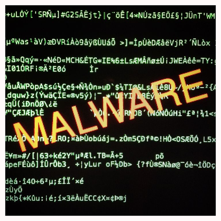 Malware over lines on code on a computer screen