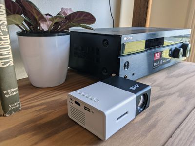 A projector connected to speakers through an AVR