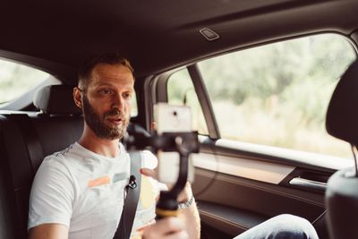 Man in the car with camera