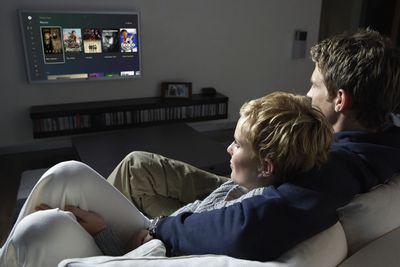 A couple choosing a movie to watch on Xbox Series X S.