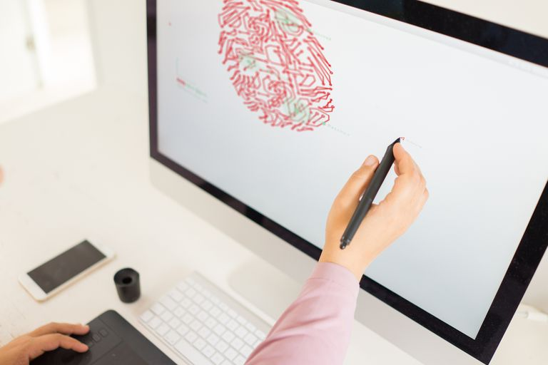 Person using stylus to draw directly onto computer screen