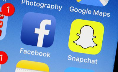 A collection of apps on a smartphone screen including the Snapchat app.