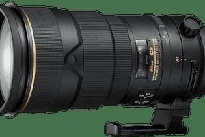 Nikon zoom lens against grey background.
