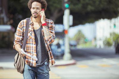 Man talking on cell phone in crosswalk
