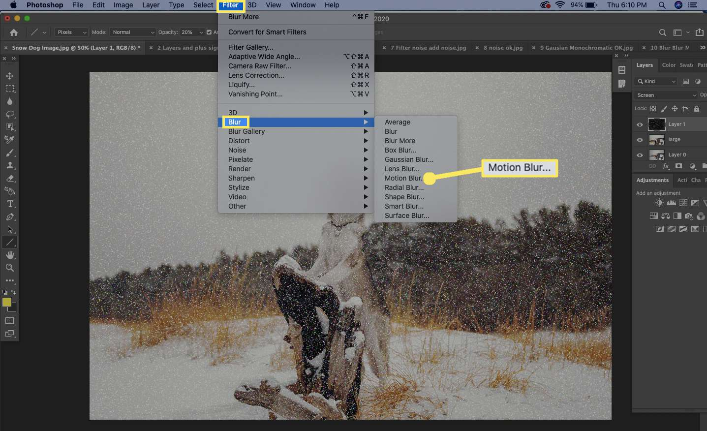 Select Filter from the top menu and then select Blur > Motion Blur.
