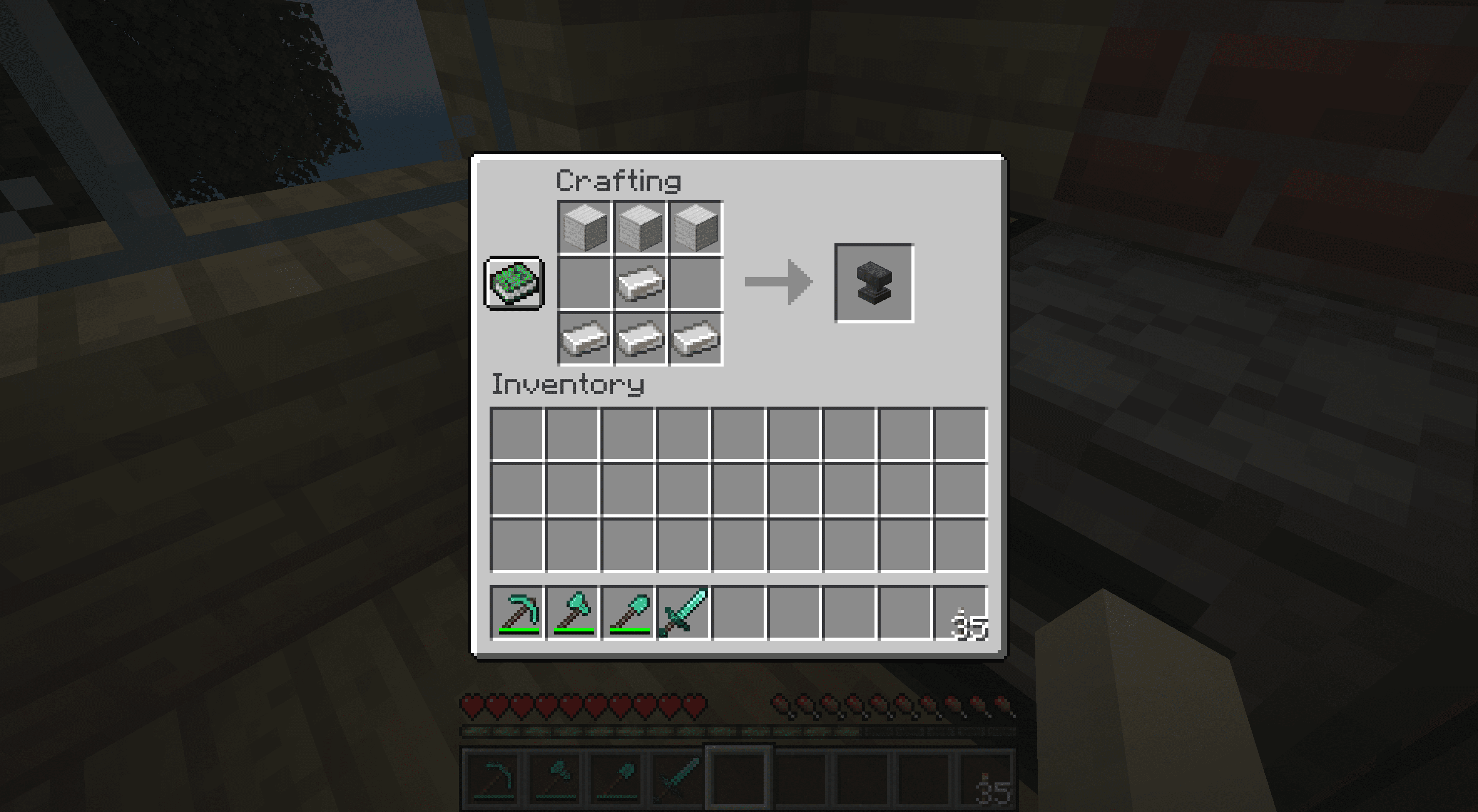 Crafting an anvil in Minecraft.