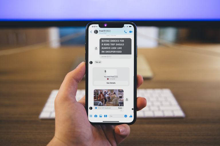 hand holding iPhone with Facebook Messenger on the screen