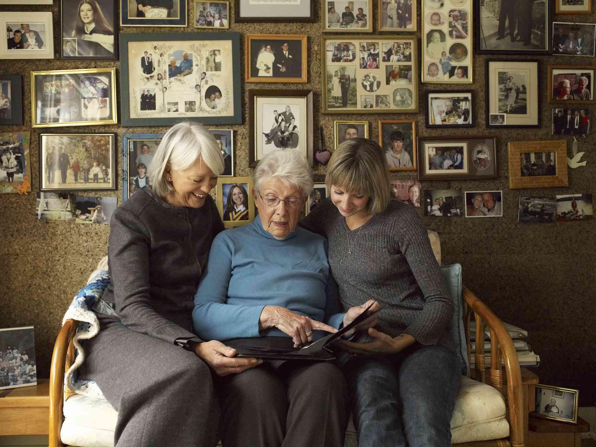 Three generations looking at photographs