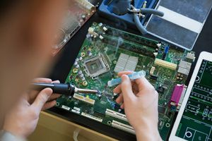 Engineer assembling circuit board