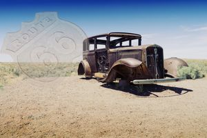 Route 66 watermark superimposed over picture of an old car.