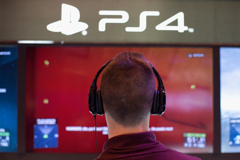Guy in headphones at a PS4 booth
