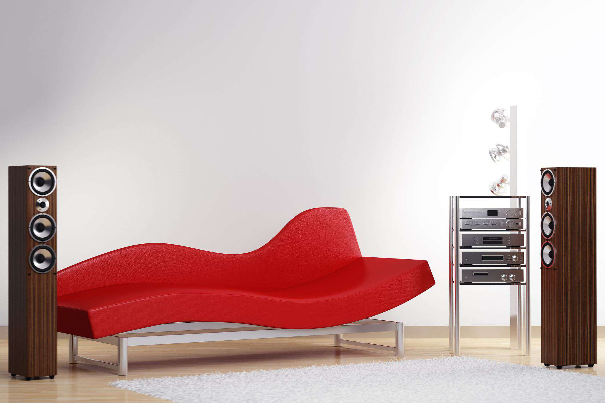 Standing floor speakers and a home receiver system on either side of a reclining couch