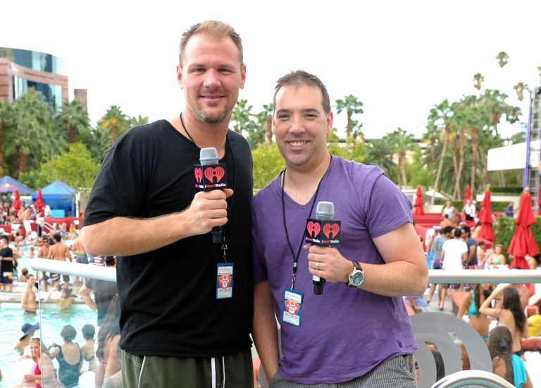 JohnJay and Rich at holding microphones at pool party