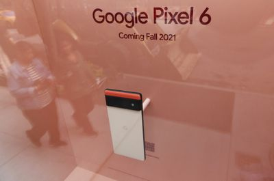 A Google Pixel 6 mobile phone sits in a display window at their corporate store on October 12, 2021 in New York City.
