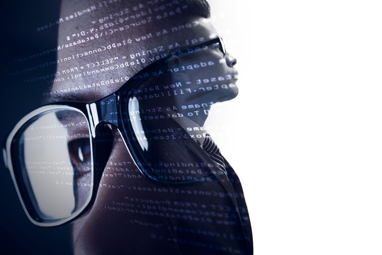 The double exposure image of the businessman standing overlay with source code and programmer image and copy space. The concept of programming, cyber security, business and internet of things.