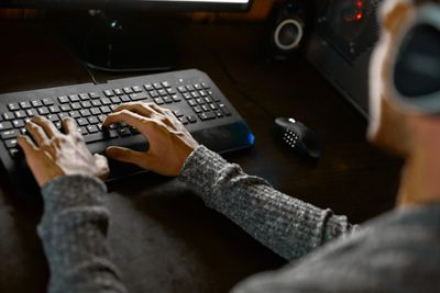 Gamer using a keyboard
