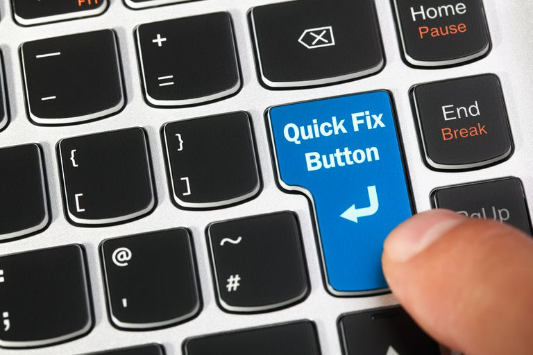 Computer keyboard enter key with a magic quick fix button concept