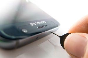 Opening a SIM card slot