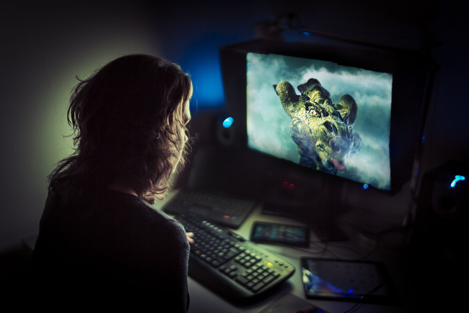 Computer gamer playing late at night