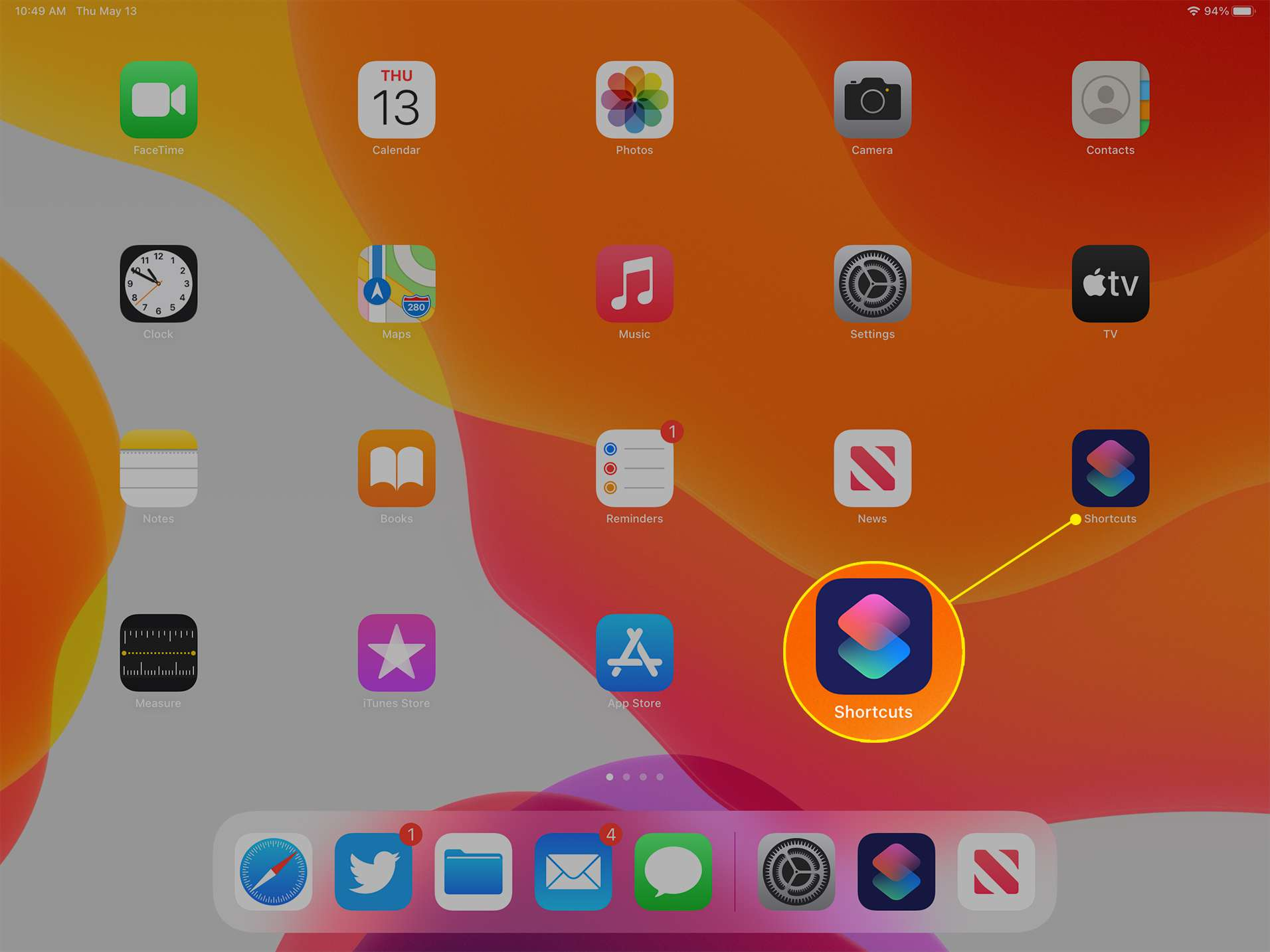 iPad desktop with the Shortcuts icon highlighted