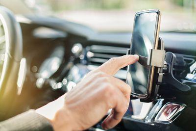 Someone using a smartphone in a car.