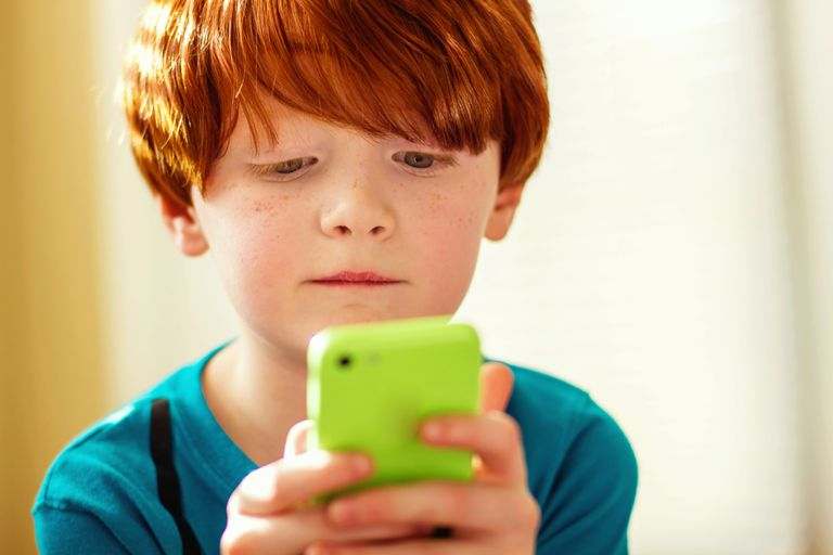 Boy playing with smart phone