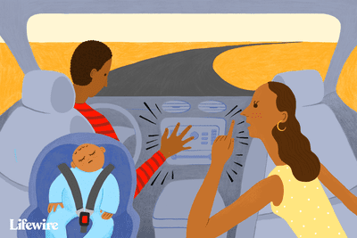 Family trying to shush a loud car radio for a sleeping baby