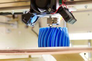 A 3D printer printing a piece