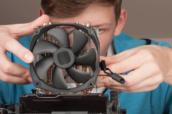 A boy fixing a CPU fan