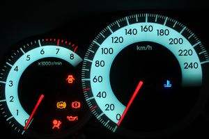 Automotive dashboard showing ABS light and other indicators lit up