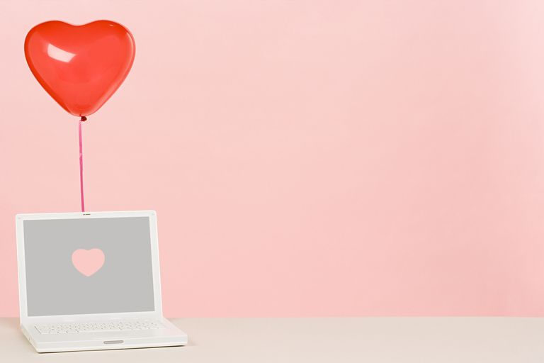 illustration of a laptop with a red heart-shaped balloon tied to it