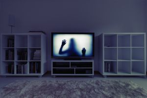 Silhouette of girl on television